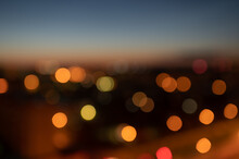 Abstract Unfocused Lights Background. Twilight Background With Bokeh Light Circles