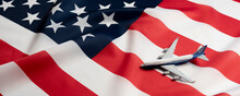 Airplane On The  Usa Flag As A Symbol Of Passenger Transportation