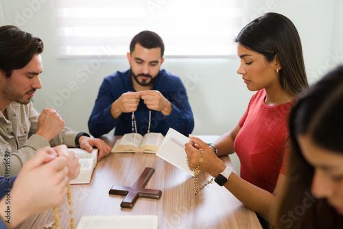 Fotografie, Obraz Faithful men and women saying prayers to God