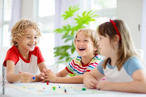 Family playing board game. Kids play. Fotobehang