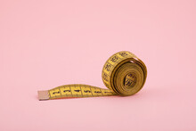 Yellow Tailor Measuring Tape On Pink Background