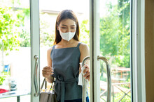 Asian Customer Using Tissue Paper For Open The Door.