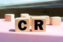 CR Word Background On Wood Blocks. Business Concept