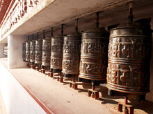 Metal Brass Prayer Wheels On Wall Of Hariti Shrine Or Ajima Hindu Temple At Swayambhunath Pagoda Or Monkey Temple For Nepali People And Foreign Traveler Rotate Respect Praying In Kathmandu, Nepal