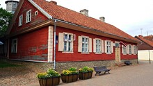 Wooden House With A Red Tiled Roof In The Latvian City Of Kuldiga On July 4, 2020
