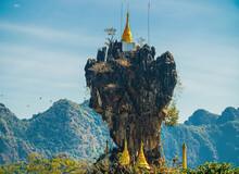 Amazing Buddhist Kyauk Kalap Pagoda Under Blue Sky. Hpa-An, Myanmar (Burma)