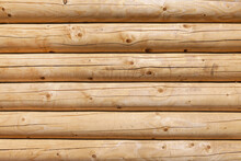 Modern, New, Clean Log Wall Made Of Round Logs Of Natural Color