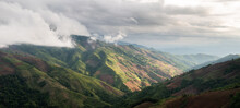 Aerial View Flying Above Lush Green Tropical Rain Forest Mountain With Rain Cloud Cover During The Rainy Season On The Doi Phuka Mountain Reserve National Park. In, The Northern Thailand