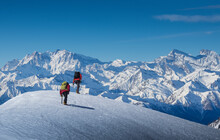 France, Haute Savoie, Chamonix, Climbers Ascending Snowy Slope In Area Of Mont Blanc