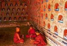 Myanmar, Shan State, Inle Lake, Novice Buddhist Monks Lighting Candles In Shwe Yan Pyay Monastery