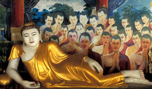 Myanmar, Mandalay, Reclining Buddha Statue And Paintings In Buddhist Temple