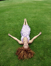 Young Woman Lying In Lawn