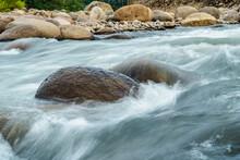 Rapid And Powerful Water Flow Between Rocks