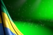 Leinwandbild Motiv cute image of Gabon flag hangs in corner on green with bokeh and empty space for your text - any celebration flag 3d illustration..