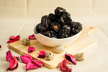 Dried Ajwa Dates In A Bowl.Ajwa Dates Are A Great Source Of Fibre That Benefits The Digestive System.This Dates Variety Is One Of The Best Ingredients For Muscle Development, Brain Health And Vitality