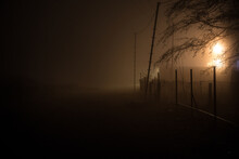 Night Street Country Road With Buildings And Fences Covered In Fog Lamp . Or Mysterious Night In Azerbaijan Mountain Village