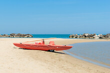 Red Lifeboat On Beach In Italy