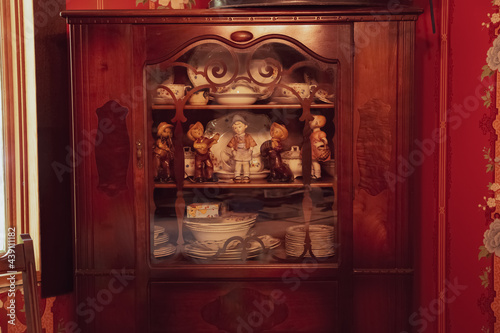 Obraz na plátně Retro Western dolls wooden shelf with antique cutleries, tea cups and plates