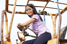 Asian Woman On An Old Car Wreck