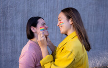 Lesbian Girls Having Fun Painting Themselves And With The Lgtb Flag On Pride Day Lgtb Concept