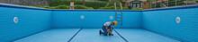 Repairman Is Repairing Pool With Equipment. Pool Maintenance Style.