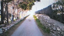 Distorted VHS Tape Effect: Traveling On A Bicycle On A Country Road, Discovering That It Leads To The Sea.