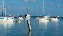 Boats In Marina With Artificial Reef Warning Sign