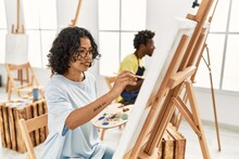 African American Artist Couple Smiling Happy Painting At Art Studio.