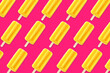 Leinwandbild Motiv Colorful summer pattern. Bright yellow ice pops on a bold pink background. Top view.