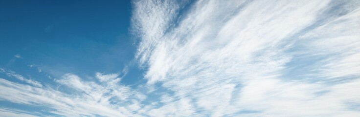 Clear blue sky with glowing white clouds after the storm. Dramatic cloudscape. Concept art, meteorology, weather, heaven, hope, peace, graphic resources, picturesque panoramic scenery