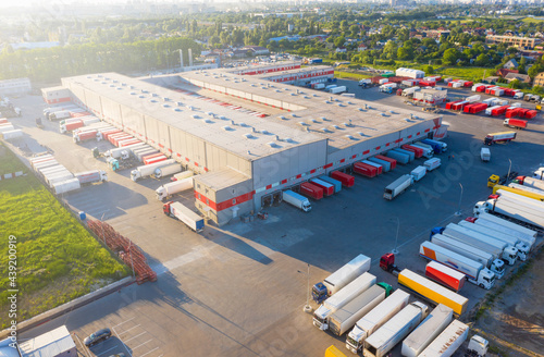 Logistics park with warehouse and outside storage of wooden pallets Fototapet