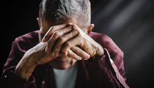 Senior Man Covering His Face With His Hands. Depression And Anxiety