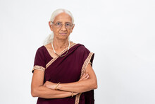 Elderly Indian Woman Standing With Her Arms Folded. Senior Woman Smiling And Looking Into The Camera