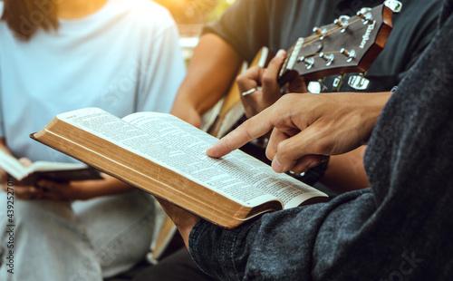 Obraz na plátně Group of people reading bible,praying and worship god.