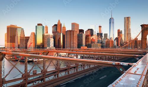 Obraz na plátně New York City Brooklyn Bridge in Manhattan closeup with skyscrapers and city skyline over Hudson River