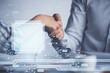 Leinwandbild Motiv Double exposure of data theme hologram and handshake of two men. Partnership in IT industry concept.