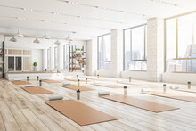 Concrete Yoga Gym Interior With Equipment, Daylight And Wooden Flooring. Healthy Lifestyle Concept. 3D Rendering.