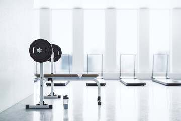 Modern gym interior with empty mockup space, equipment and daylight. Mock up, 3D Rendering.