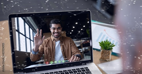 Network of connections against webcam view of man on video call on laptop on wooden table