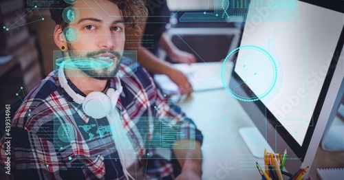 Digital interface with data processing against portrait of man sitting on his desk at office