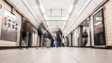 The London Underground. Long Exposure Abstract Blur Of Passengers Having Alighted At A Tube Station To Continue Their Journey.