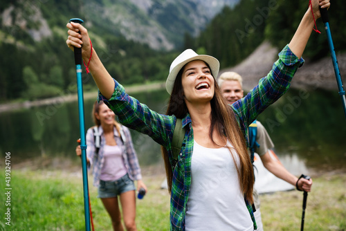 Fotografiet Group of happy hiker friends trekking as part of healthy lifestyle outdoors acti