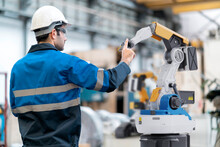 Engineer Working With Robot Arm Machine Industrial 4.0 Technology In Factory. Futuristic Innovation Digital Technology Production Line Management.