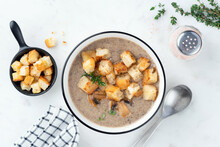 Vegetarian Cream Of Mushroom Soup With Croutons On White Marble Backgrou