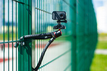 Compact Action Camera On A Flexible Tripod. Outdoor Travel Equipment.