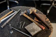 Close Up Of Diverse Jeweller Tools Lying On Table In Workshop