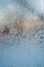 Blue Frost Pattern On A Window Glass. Winter Background. Macro Closeup Wallpaper. Banner Hoarfrost Background Template