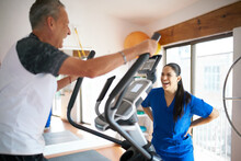 Healthcare: Physio Therapy Sports Trainer With Her Client