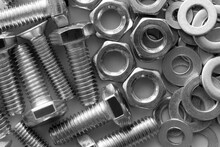 Abstract Industrial Textured Metal Background  With Many Metal Nuts And Bolts