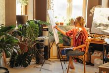 Creative Artist Painting In Studio
